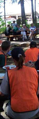 Community volunteers wearing orange vests